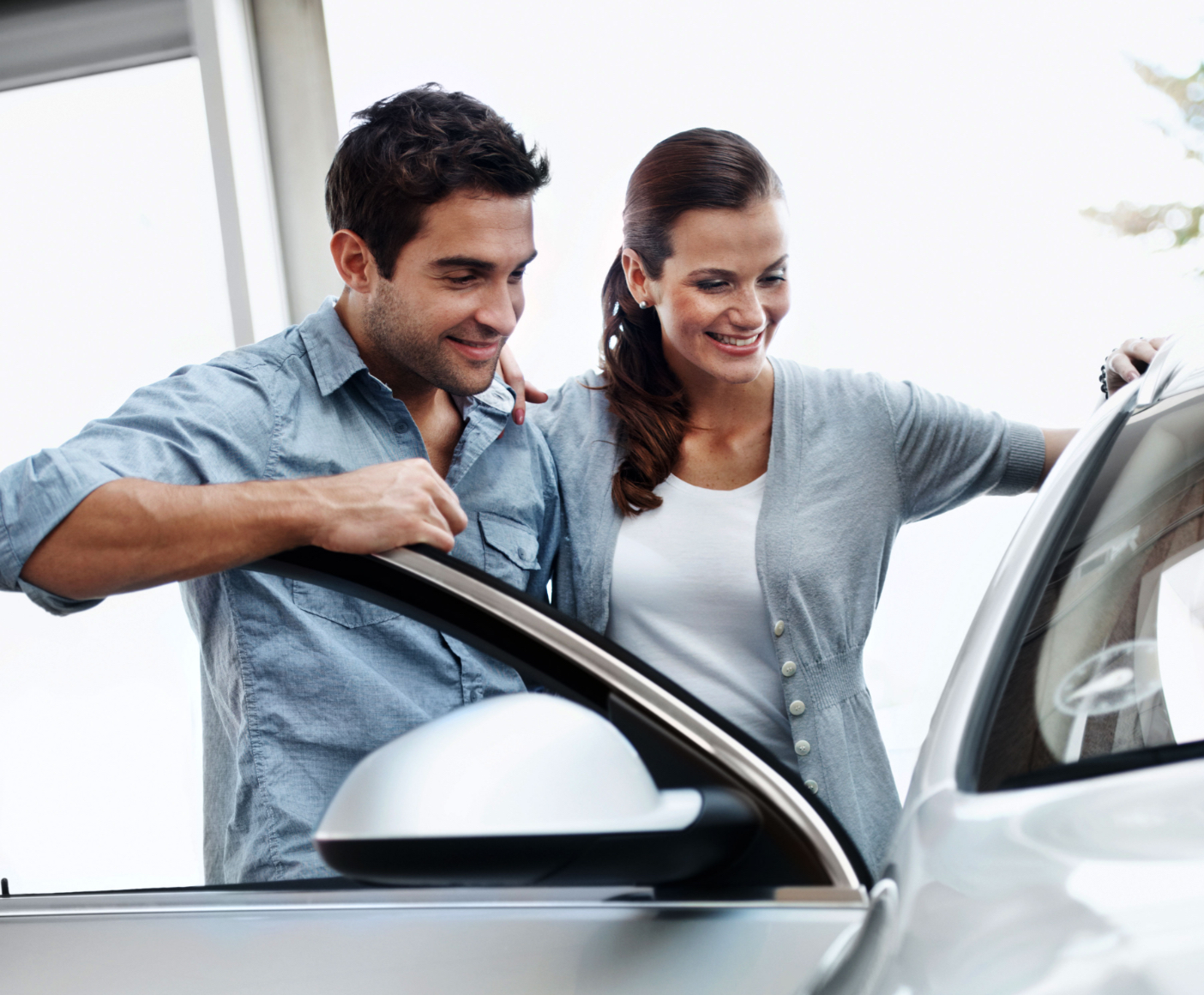 Young couple looking at a car